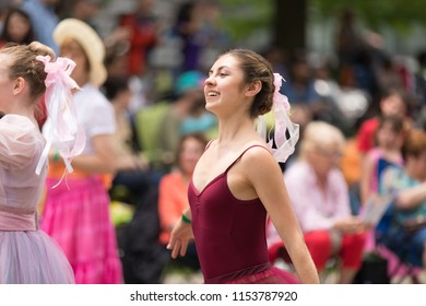 Cleveland, Ohio, USA - June 9, 2018 women wearing traditional german clothing perform the maypole dance At the abstract art festival Parade The Circle