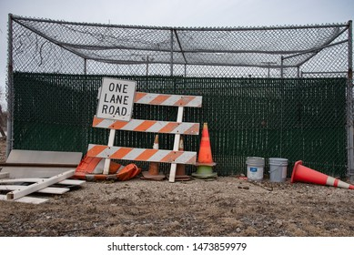 Cleveland, Ohio - USA/ March 09 2019: Miscellaneous road safety equipment resting along fence.