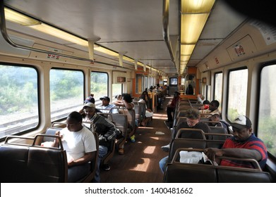 CLEVELAND, OHIO / USA - SEPTEMBER 18 2009: Seated passengers relax inside an RTA Red Line subway car bound for downtown Cleveland and Airport.