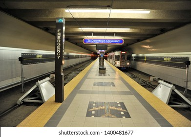CLEVELAND, OHIO / USA - SEPTEMBER 18 2009: RTA Red Line subway train arrives at platform of Airport station before returning to downtown Cleveland.