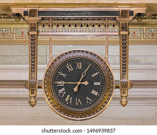 CLEVELAND, OHIO/USA - July 11, 2019: Black clock hanging in the lobby of historic City Hall on Lakeside Avenue in Cleveland