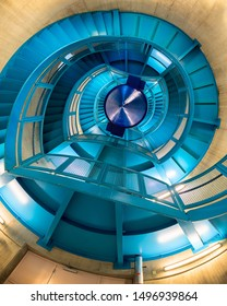 CLEVELAND, OHIO/USA - July 11, 2019: Modern and colorful spiral blue staircase in the Cleveland Public Library