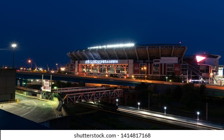 Cleveland, Ohio/USA - June 1, 2019: Cleveland Brown's Stadium(First Energy Stadium) At Night With Fan Walk Way Bridge And BillBoard Lights.
