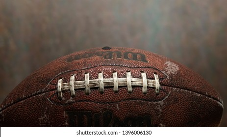 Cleveland, Ohio/USA - May 7, 2019: Closeup of Rugged looking Pro Football Pig Skin. Professional football is the highest level of competition in gridiron.