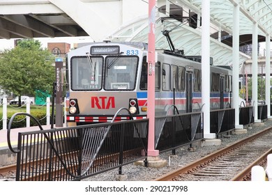 CLEVELAND, USA - JUNE 29, 2013: People ride RTA Rapid Transit light rail in Cleveland. Greater Cleveland Regional Transit Authority (RTA) exists since 1975 and operates 37 miles of rail.