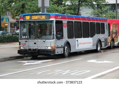 CLEVELAND, USA - JUNE 29, 2013: People ride RTA bus in Cleveland. Greater Cleveland Regional Transit Authority (RTA) exists since 1975 and serves 49 million annual rides.