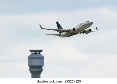 CLEVELAND, USA - JUNE 30, 2015: United Airlines Boeing BOEING 737-724 at Cleveland Hopkins International Airport taking off with the control tower in view.Boeing,