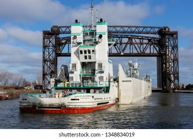 Cleveland, USA - March 23, 2019:  The tugboat Samuel de Champlain and her articulated barge Innovation head to the LaFarge plant on the Cuyahoga River to begin the 2019 shipping season