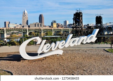Cleveland, USA - October 21, 2018 - View over Cleveland, Ohio with the Cleveland sign in front seen from the Hope Memorial Bridge