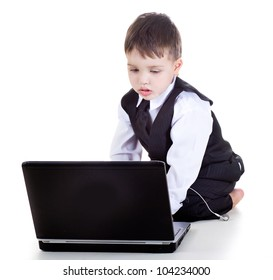 clever boy with a laptop isolated in studio