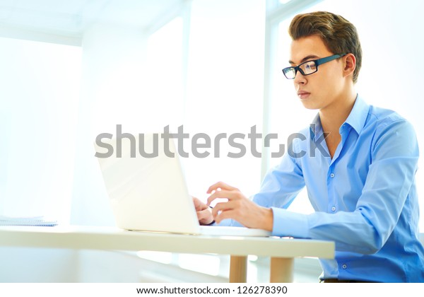 Clever business intern being busy with office work