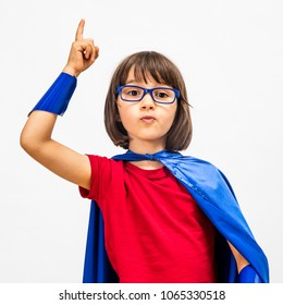 clever fun super hero child with eyeglasses raising her smart finger for surprising idea, dynamic education and young critical mindset over white background