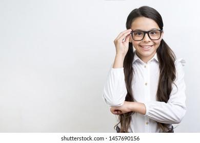 Clever Hispanic schoolgirl standing in glasses