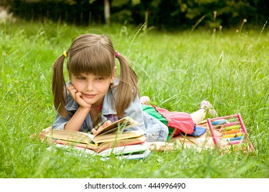 clever little pupil reading a book