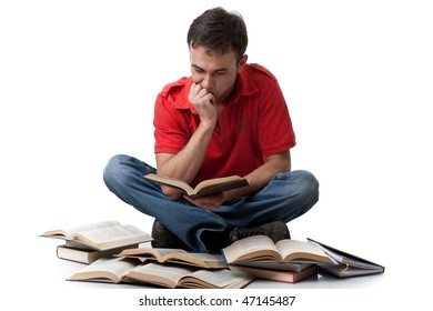 The clever young man  sitting with books on a white background.