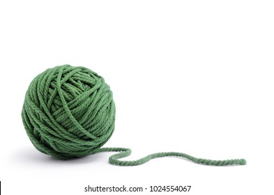 Clew of green thread for knitting isolated on white background