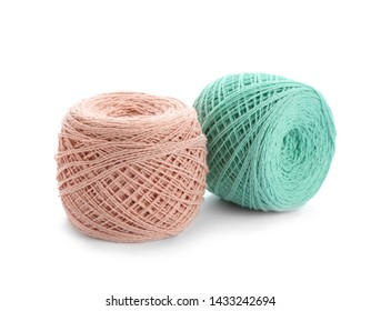 Clews of colorful knitting threads on white background