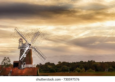 Cley Windmill located on the Norfolk coast dating from the 18th century. Today it is a stunning bed & breakfast, wedding venue, and has been used for film and TV promotions. Flock of circling birds
