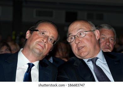 CLICHY-LA-GARENNE, FRANCE - APRIL 28, 2011 : Francois Hollande speaking to Michel Spin during meeting for the Socialist primary