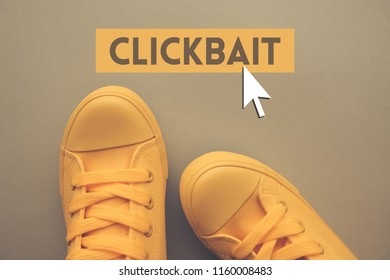 Clickbait internet web article concept with yellow sneakers from above