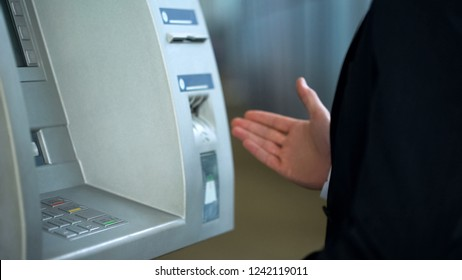 Client annoyed at ATM work, card got stuck in machine, banking system failure