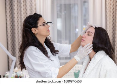 A client at a beautician's appointment, consultation, face shaping, preparation for upcoming procedures, visual examination of problem areas