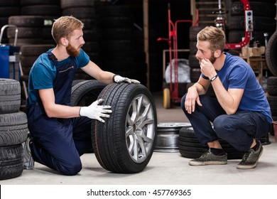 Client buying tires from mechanic at service.