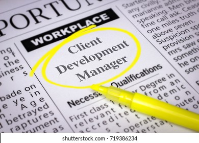 Client Development Manager - Newspaper sheet with ads and job search, circled with yellow marker, Blurred image and selective focus
