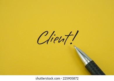 Client! note with pen on yellow background