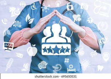 Client Satisfaction Health Care concept. Doctor holds hands over people group stars icon on a virtual graphical medical user interface.