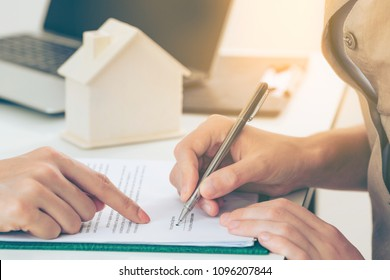 Client signs home loan or divorce document with real estate property agent or lawyer.