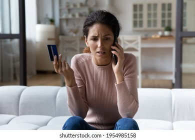 Client support line. Worried young hispanic woman ebank customer contact call center service having problem with payment by credit card. Anxious millennial lady talk to personal bank manager ask help - Shutterstock ID 1954985158