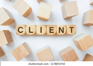 Client word on wooden cubes