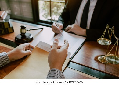 Clients come to seek advice for the law regarding privacy violations with the lawyer at the office.