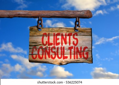 Clients consulting motivational phrase sign on old wood with blurred background