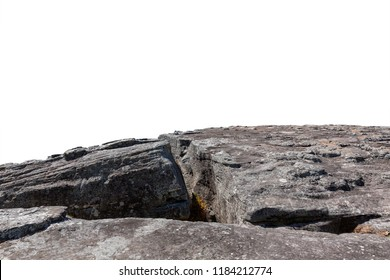 Cliff crack stone located part of the mountain rock isolated on white background.