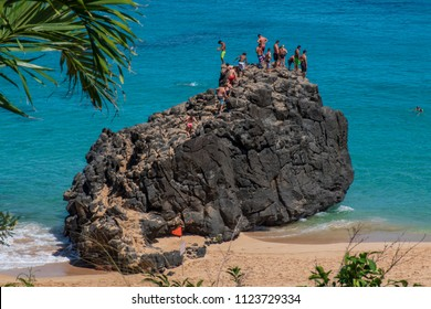 Cliff diving at Waimea Bay in Haleiwa, Hawaii.
