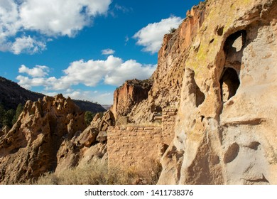 Cliff dwelling ruins and volcanic tuff rock formations in Bandelier National Monument, New Mexico
