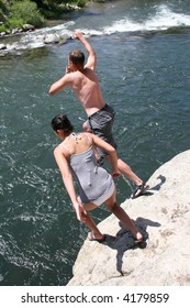 Cliff jumping into a mountain river in Montana