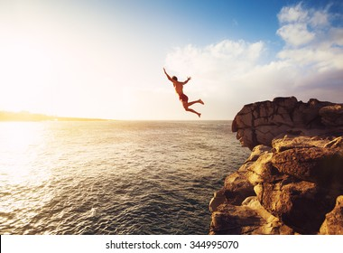 Cliff Jumping into the Ocean at Sunset, Summer Fun Lifestyle