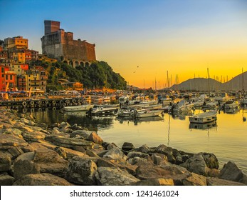 Cliff of Lerici Italian city at sunset. Gulf of Poets and San Giorgio castle on the background at in La Spezia Ligurian Coast of Italy.