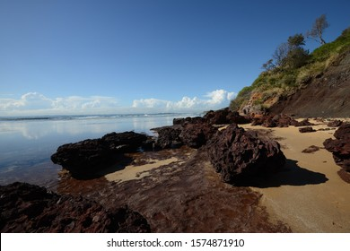 Cliff on reef on placid water - Long Reef  Sydney