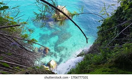 Cliff Overlooking Light Blue Water. Taken near Maro Beach Nerja Spain