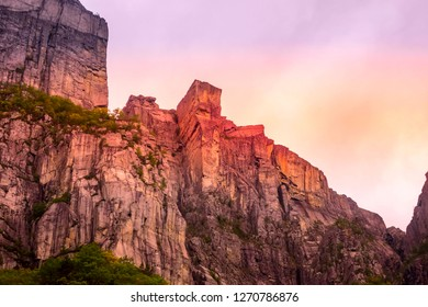 Cliff Preikestolen or Pulpit Rock sunset view in fjord Lysefjord, Norway