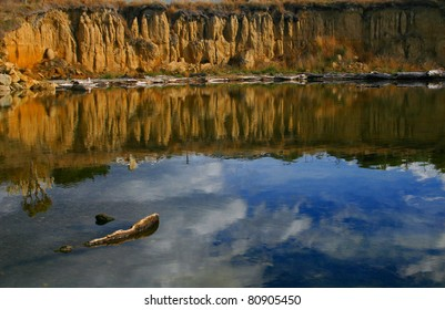 Cliff reflections in the estuary, Kakanui, New Zealand