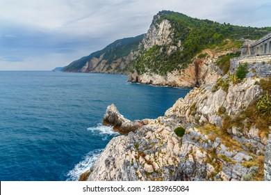Cliff sea coast with Grotta di Lord Byron in Portovenere or Porto Venere town on Ligurian coast. Province of La Spezia. Italy