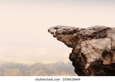 Cliff stone with mountain on clouds sky.