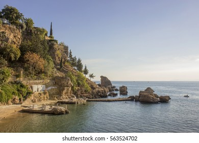 Cliff with tropical trees and the beach near the sea / Cliff over the sea