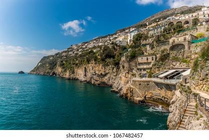 The cliffed coastline at Marina di Praia, Praiano, Italy looking towards Praiano