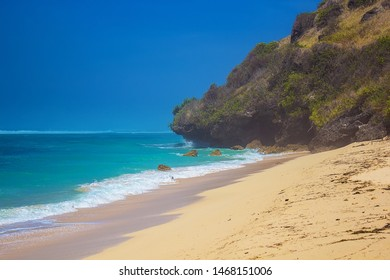 Cliffs and azure water of Indian ocean on Gunung Payung Beach, Bali island, Indonesia. Beautiful secret beach not far from famous Pandawa beach. Selective focus, water haze.Travel and vacation concept